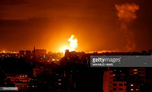 TOPSHOT A picture taken on on October 27 2018 shows a fireball exploding during Israeli air strikes in Gaza City