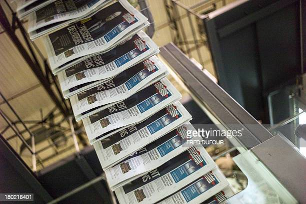 Picture taken on september 09 2013 in La Courneuve suburbs of Paris shows freshly printed copies of French newspaper Liberation getting out of a...
