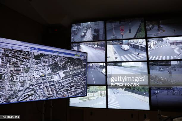 A picture taken on September 1 2017 shows control screens in the command room of public order and traffic at the Paris Police Prefecture on September...