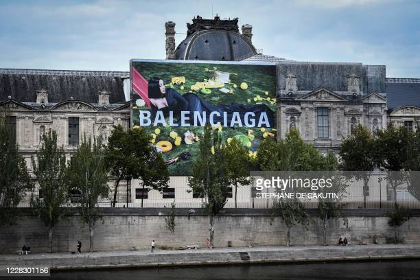 Picture taken on September 1 shows a billboard of the Balenciaga fashion brend featuring its new icon, US singer Cardi B, on a wall of the Louvre...