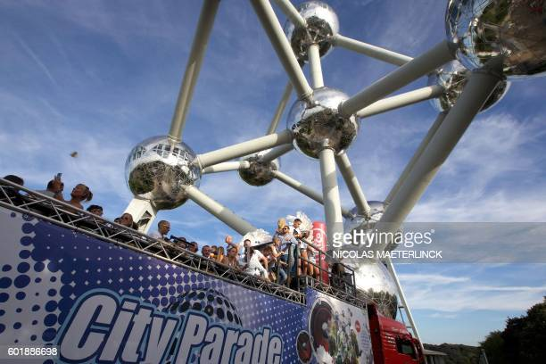 A picture taken on September 10 2016 shows people passing by the Atomium building designed by André Waterkeyn and architects André and Jean Polak...