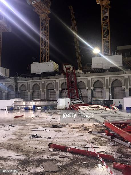 A picture taken on September 11 2015 inside the Grand Mosque of Saudi Arabia's holy Muslim city of Mecca shows a construction crane after it crashed...