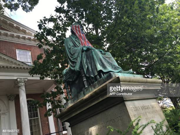 Picture taken on September 11 2016 showing the statue of Roger Brooke Taney Chief Justice of the United States Supreme court face covered with a flag...