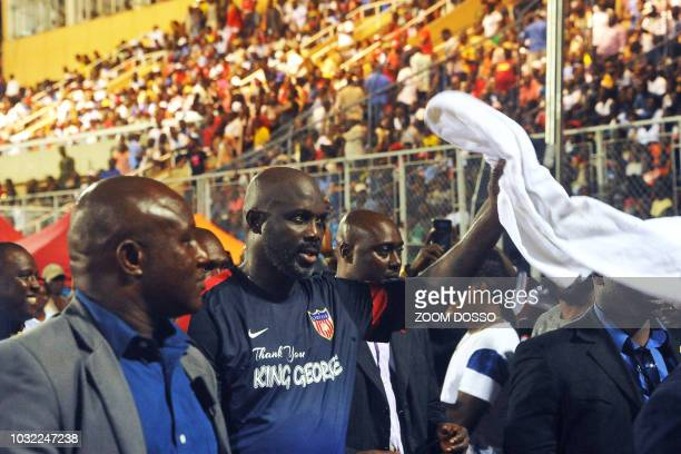 Picture taken on September 11 shows Liberian president and football legend George Weah acknowledging the crowd after taking part in a friendly...
