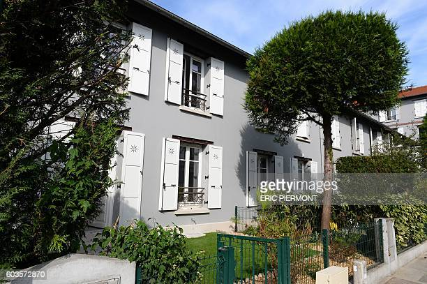 A picture taken on September 12 2016 shows part of the La Ruche bulidings the first HLM of France in SaintDenis near Paris White wooden shutters a...