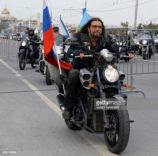 A picture taken on September 13 2014 shows Alexander Zaldostanov aka Surgeon leader of the Night Wolves bikers club as he rides a motorbike in Moscow...