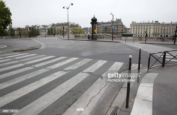 A picture taken on September 13 2015 in Paris shows the Quai des Tuileries without road traffic ahead a carfree day throughout the city on September...