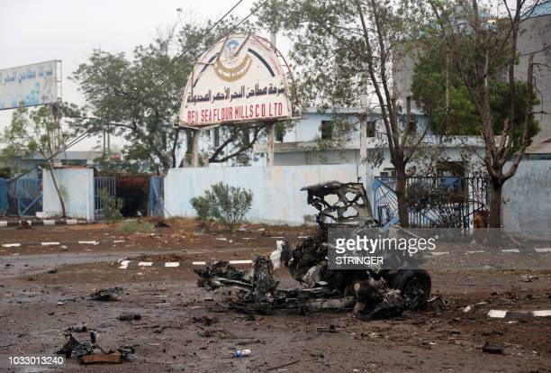 A picture taken on September 13 2018 shows the carcass of a car reportedly destroyed in an air strike during clashes between fighters loyal to...