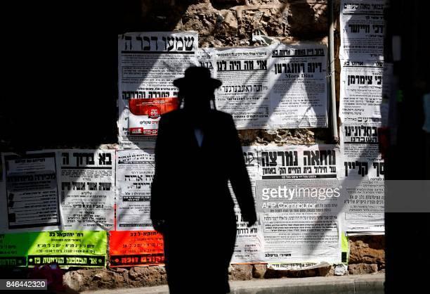 TOPSHOT A picture taken on September 13 shows an UltraOrthodox Jew walking in the UltraOrthodox neighborhood of Mea Shearim of Jerusalem Israel's...