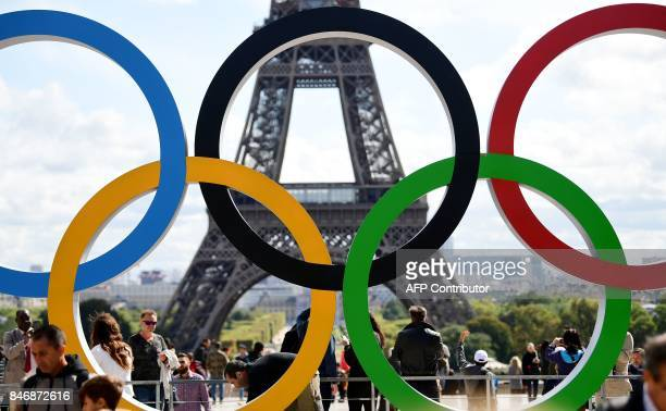 A picture taken on September 14 2017 shows the Olympics Rings on the Trocadero Esplanade near the Eiffel Tower in Paris after the International...