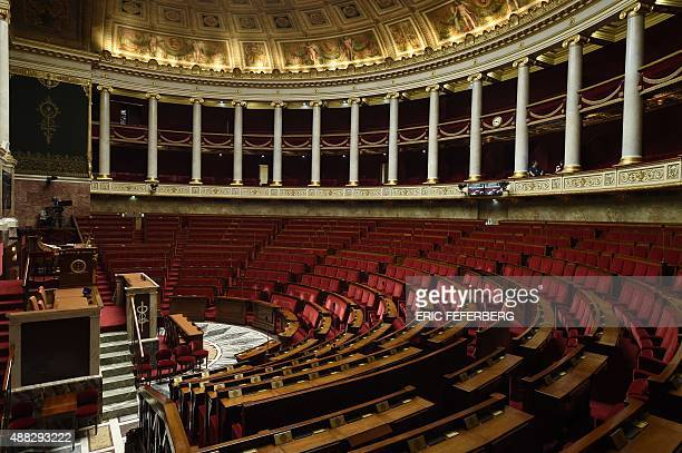 A picture taken on September 15 2015 in Paris shows the empty hemicycle of the French national Assembly AFP PHOTO/ERIC FEFERBERG