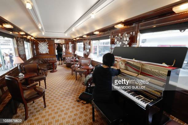 """Picture taken on September 15, 2018 shows the bar coach """"Train Bleu"""" of the legendary train """"Orient Express"""" in Paris during the European Heritage..."""
