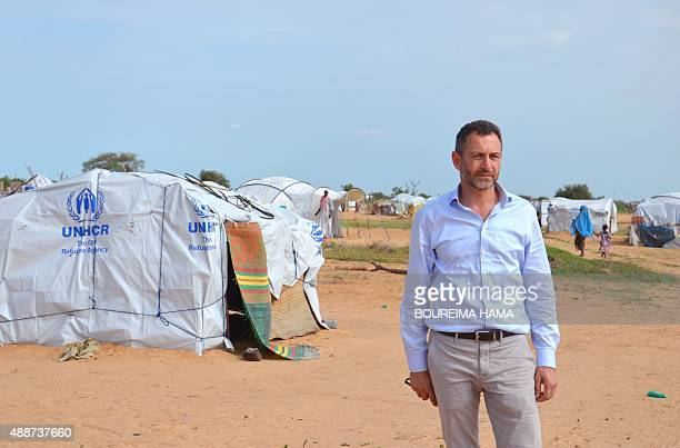 A picture taken on September 16 2015 shows Toby Lanzer United Nations humanitary regional coordinator for the Sahel posing in front of Assaga refugee...