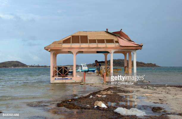 A picture taken on September 16 2017 in Marigot on the French Caribbean island of Saint Martin shows a damaged jetty after the island was hit by...