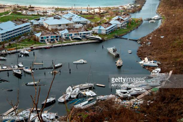 A picture taken on September 16 2017 on the French Caribbean island of Saint Martin at the Anse Marcel shows smashed boats and damaged buildings...