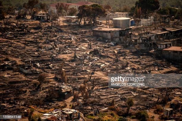 Picture taken on September 16 shows the remains of the burnt Moria migrant camp on the Greek Aegean island of Lesbos, after it was destroyed by a...