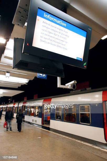 A picture taken on September 17 2012 shows a RER commuting train stopping on a platform at the Gare du Nord railway station in Paris after RER...