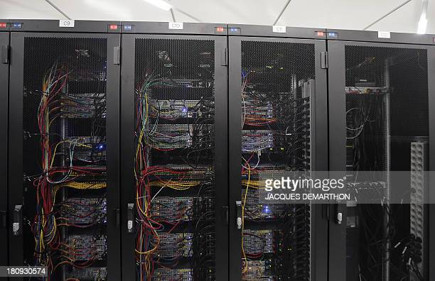 A picture taken on September 17 2013 in SaintDenis outside Paris shows cabling servers 'clients' at the French branch of Digital Realty a company...