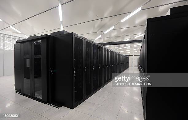 A picture taken on September 17 2013 in SaintDenis outside Paris shows a room of cabling servers 'clients' at the French branch of Digital Realty a...