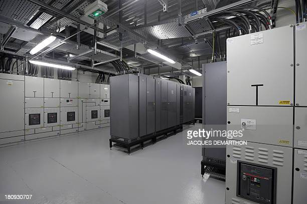 A picture taken on September 17 2013 in SaintDenis outside Paris shows a room of power inverters at the French branch of Digital Realty a company...