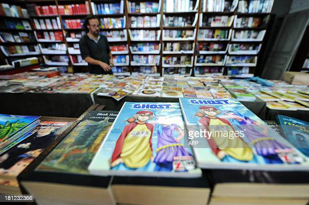 STORY A picture taken on September 17 2013 shows issues of 'Ghost' a manga comic book created by Algerian artist Fella Matougui displayed in a book...