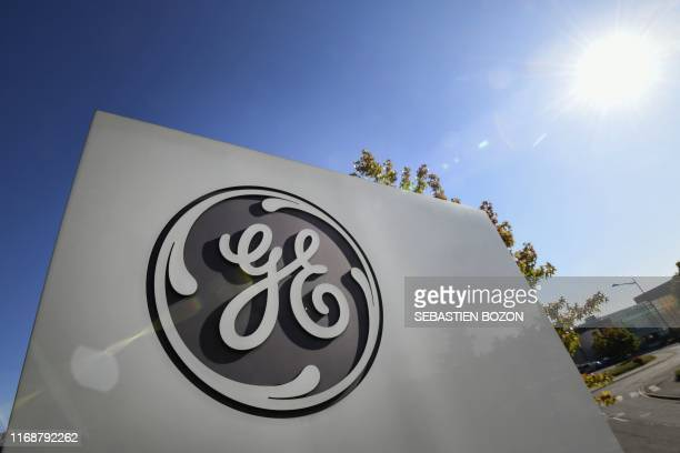 Picture taken on September 17, 2019 shows the logo of US giant General Electric, in Belfort, eastern France,. - About a hundred employees of General...
