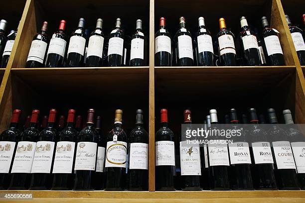 A picture taken on September 18 2014 shows bottles of red wine from Bordeaux vineyards in a wine shop in Paris Sales of baginbox represent 348% of...