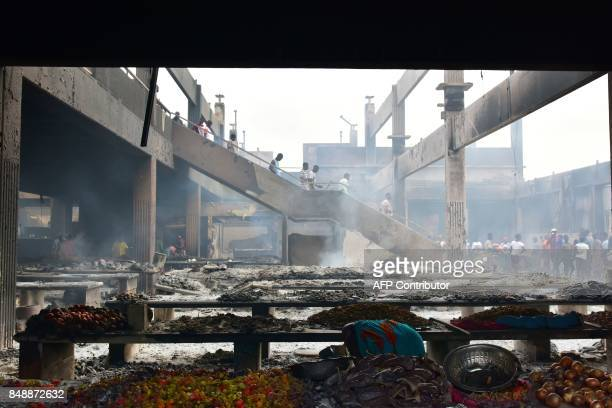 A picture taken on September 18 2017 in Abobo neighborhood of Abidjan shows the market after a fire devastated the building during the night / AFP...