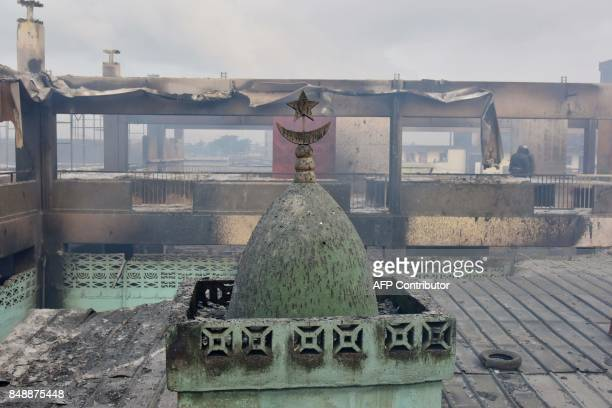 A picture taken on September 18 2017 in Abobo neighborhood of Abidjan shows a detail of the mosque in the market after a fire devastated the building...