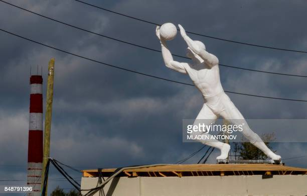 A picture taken on September 18 2017 shows a Soviet time sculpture placed at the Yekaterinburg Arena in Yekaterinburg Yekaterinburg Arena will host...