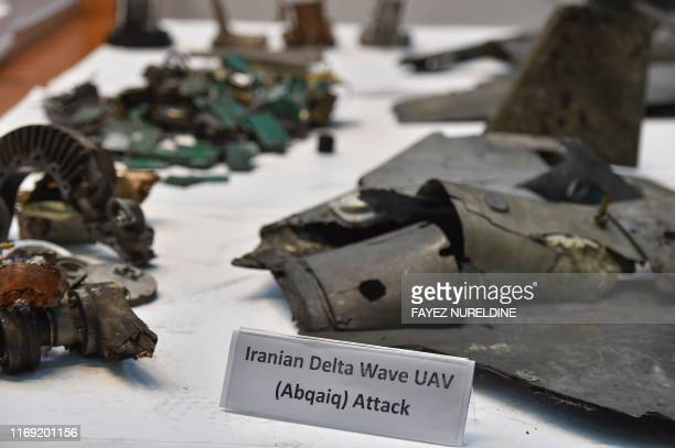 TOPSHOT A picture taken on September 18 2019 shows displayed fragments of what the Saudi defence ministry spokesman said were Iranian cruise missiles...