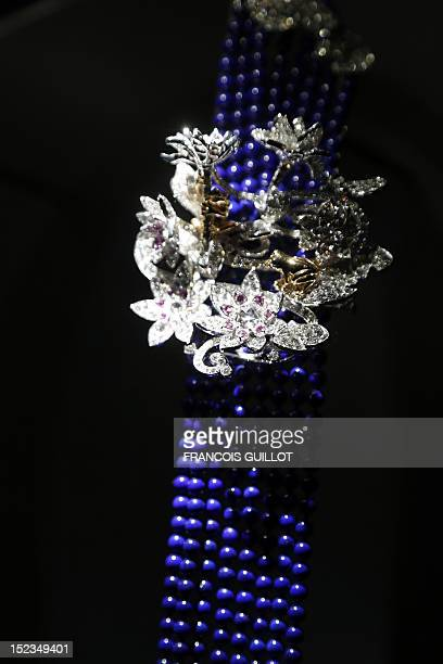 A picture taken on September 19 2012 in Paris shows a long necklace entitled displayed during an exhibition devoted to Van Cleef Arpels at the Arts...