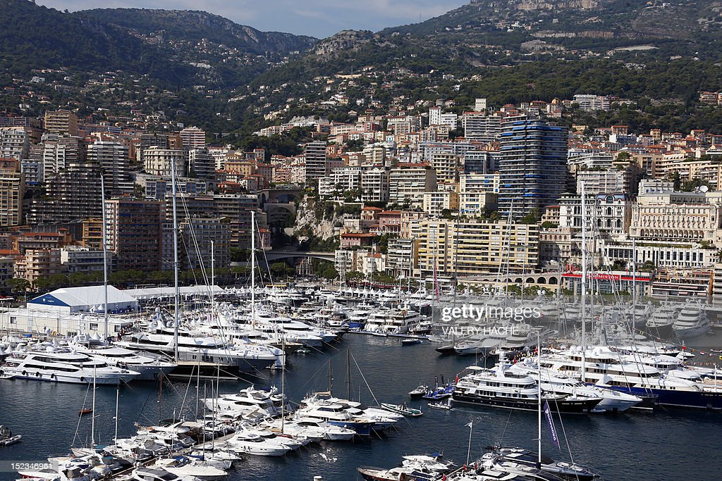 A picture taken on September 19, 2012 shows a general view in Monaco with yachts moored at Port Hercules during the 22th edition of the International Monaco Yacht Show. The Monaco Yacht Show is considered the most prestigious pleasure boat show in the world with the exhibition of 500 major companies in the luxury yachting and a hundred super and megayachts afloat. The event runs until September 22.