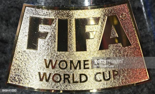 A picture taken on September 19 2017 in Paris show the title on the trophy of the 2019 FIFA Women World Cup in France The competition which runs from...