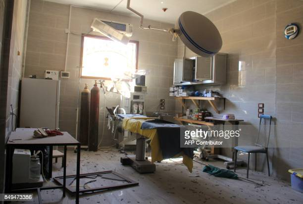 A picture taken on September 19 2017 shows a hospital emergency room covered in rubble and debris following a reported air strike by Syrian...