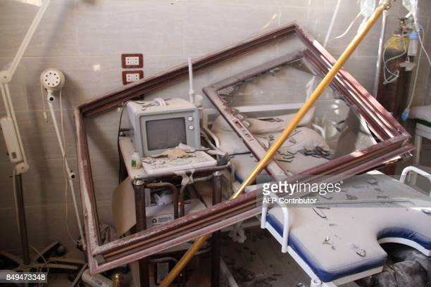 A picture taken on September 19 2017 shows an ultrasound machine and a hospital bed covered in rubble and debris following a reported air strike by...