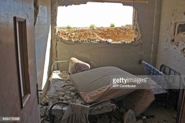 TOPSHOT A picture taken on September 19 2017 shows hospital beds covered in rubble and debris following a reported air strike by Syrian government...