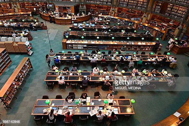 A picture taken on September 2 2016 shows the people working and studying in the reading 'oval' room at the BNF French National Library in central...