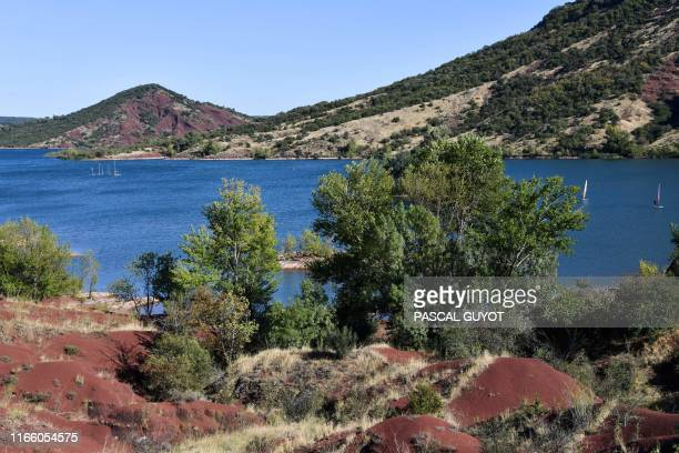 Picture taken on September 2, 2019 shows a general view of the Lake Salagou near Clermont l'Herault, in southern France. - In 1969, the articifial...