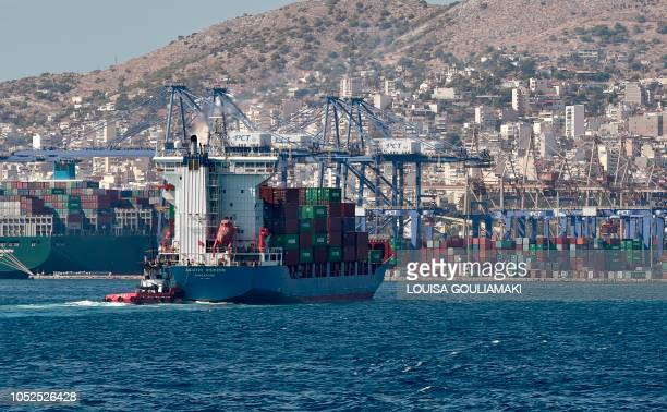 A picture taken on September 20 2017 shows a view of the container terminal in the port of Piraeus Chinese shipping giant Cosco said it has ambitious...