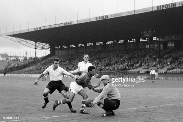 A picture taken on September 21 1952 shows Racing's Jacques Foix and Krupski watching as Racing's goalkeeper Pierre Machet deflects the ball from...