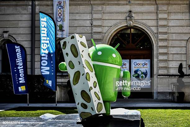 A picture taken on September 21 2016 shows a statue donated by Google during its inauguration in Montelimar as Google decided to launch a new version...