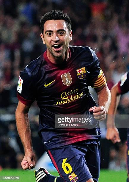 Picture taken on September 22, 2012 shows Barcelona's midfielder Xavi Hernandez celebrating after scoring a goal during their Spanish League football...