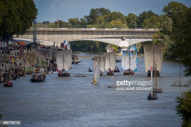 A picture taken on September 23 2015 shows boats and sailors during the biggest gathering of river navigation along the Loire in Orleans central...