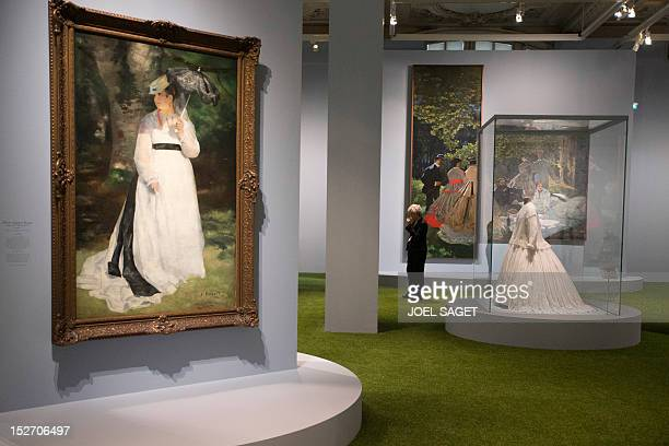 A picture taken on September 24 2012 shows a painting by PierreAuguste Renoir entitled Femme à l'ombrelle and displayed during the exhibition...