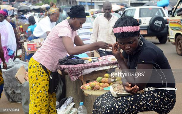 STORY Picture taken on September 24 2013 of people shopping at an openair market in Conakry Guinea a country on the cusp of its first parliamentary...