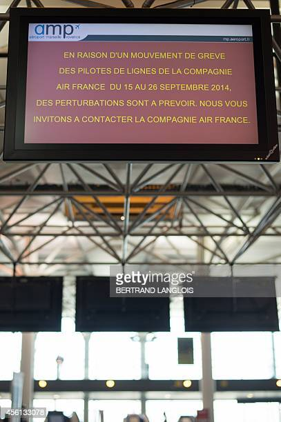 Picture taken on September 26, 2014 in Marseille Provence airport in Marignane, southern France, shows a board announcing Air France cancelled...