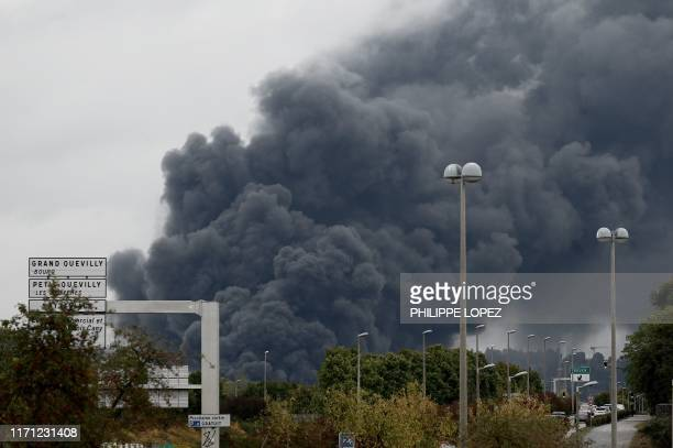 TOPSHOT A picture taken on September 26 2019 from SottevillelesRouen shows smoke billowing from a Lubrizol factory classified SEVESO highthreshold...