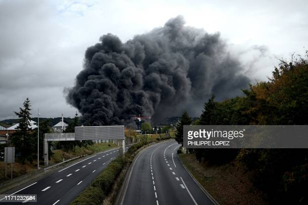 A picture taken on September 26 2019 shows smoke billowing from a Lubrizol factory classified SEVESO highthreshold site on fire in Rouen Residents of...