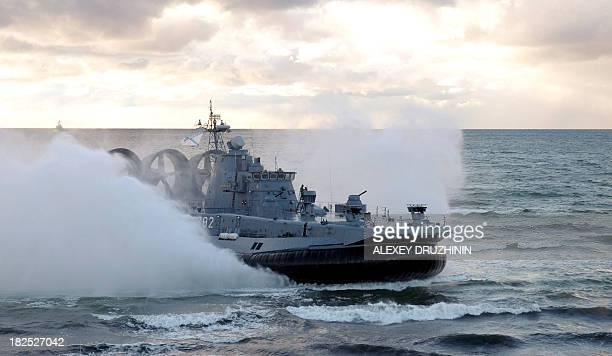 A picture taken on September 26 shows a Russian Navy Zubr class hovercraft lands on the seashore during a joint military exercises of Russian and...